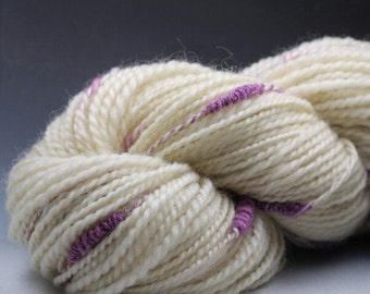 Handspun Yarn: White Coopsworth Sheep Wool with Purple Stacks 2-ply Art Yarn