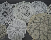 Vintage Doilies Lot of 7 round doilies 9 to 20 inches, handmade 1940s 1950s Linens