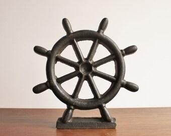 Large vintage cast iron ship wheel doorstop