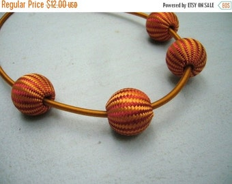 A wooven necklace in orange