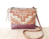 weekdayer  • small crossbody bag - geometric print • handprinted geometric print canvas - rust red - raspberry leather • vukani