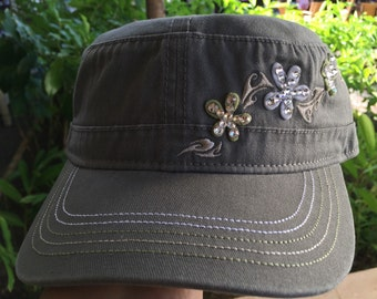 Olive-colored plumeria military style cap embellished with Swarovski Crystals