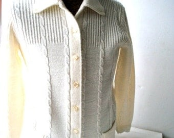 Retro  vintage 60s white acrylic  ribbed with a cable knit sweater-cardigan. Made by Cuddle Knit. Size M.