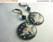 Rabbit earrings ... resin rabbit charms in antique brass with dark blue Swarovski crystals ... little bunnies