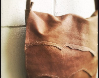 Unique messenger leather bag in sand-tan color handmade in Montreal