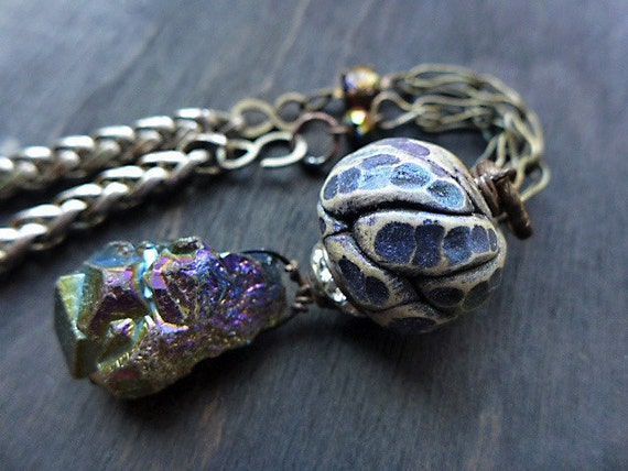 Luminous Night.  Rustic assemblage necklace with polymer clay and rainbow Aura pyrite crystal.