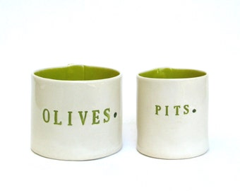 olives and pits  ...  hand built porcelain containers ...  chartreuse vessels