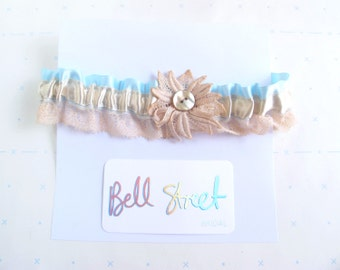 Handmade vintage style ribbon and lace wedding garter in blush, champagne and blue with lace flower