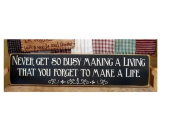 Never get so busy making a living that you forget to make a life primitive sign