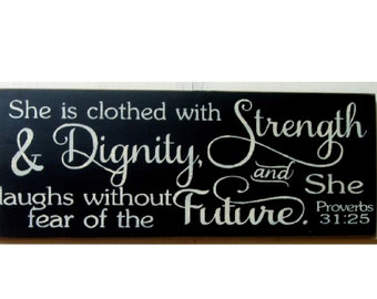She is clothed with strength and dignity and laughs without fear of the future wood sign