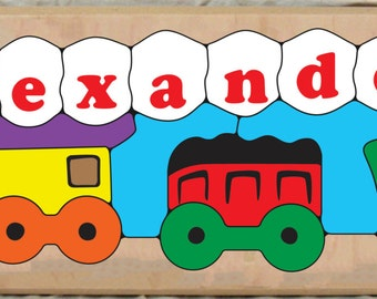 Personalized Name Long Train Puzzle... All aboard!  This educational toy train puzzle is for preschool toddler children to learn their name.