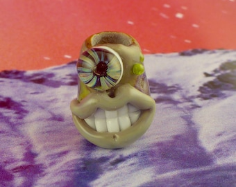 Gray one eyed monster dread bead