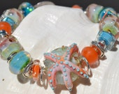 Reserve for Patrice-SEA STAR-Handmade Lampwork and Sterling Silver Bracelet