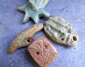 Artisan made ceramic pendants - set of 4 - light green and tan - amulets - talismans