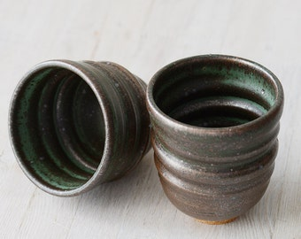 Two Wheel Thrown stoneware green and black tumblers or tea cups