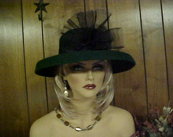 """SALE. Green wool hat with fancy netted decoration in front- fits 23- 23.5 """" Designer Mr John"""