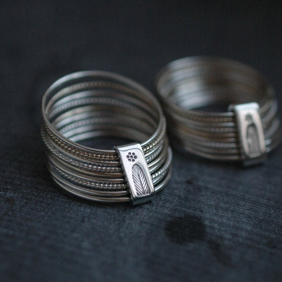 9 twist and turn silver and solid yellow gold stacking rings