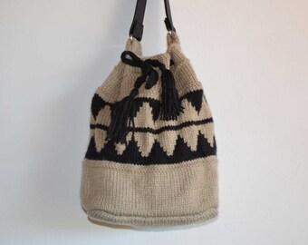 Knitted bucket bag drawstring bag large tan beige neutral brown lined shoulder bag African geometric pattern chunky yarn vinyl handle vegan