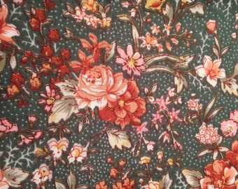 Fabric in floral pattern on green background