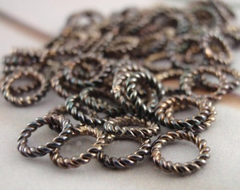 50- 18 gauge 6mm OD Fancy Twisted Soldered Jump Rings in Silver Plate and Antique Silver Plate