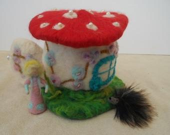 A Giant Mushroom House Fairy Home Waldorf Play Scape play Mat with miniature shroom fairy and a porcupine