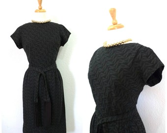 Vintage 1950s dress Black Eyelet cotton pin-up dress Fringe belt by Bowit Teller Wiggle Cocktail party dress S/M