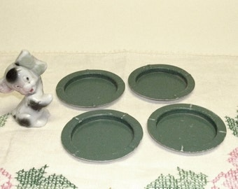 "Set of Four toy dishes ,Tin ,green with white bottoms,3"" across top"