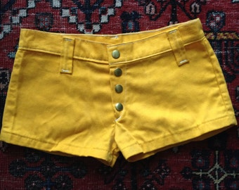 "Vintage 60s marigold HOT PANTS shorts / Brass snap front / Low slung hip huggers / Fits up to 29"" hips"