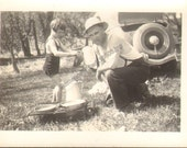 Man Cooks over Cookstove Cute Yougn Girl Plays in Background Vintage Photo  K18403