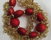 Soft crimson and delicate interlocking rings of gold necklace
