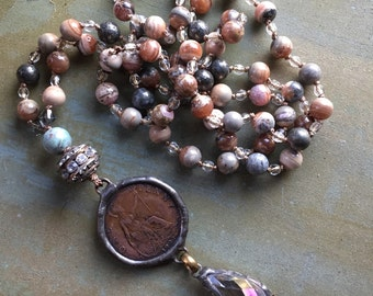 Forgivingworks necklace with old coin