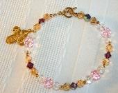 Multi-toned 4 Way cross Bracelet