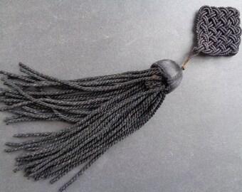 vintage long black tassel