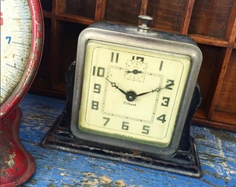 Vintage black metal Gilbert clock