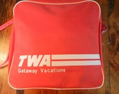 TWA Getaway Vacations vintage travel bag red nylon with white piping collapsible with strap Trans World Airlines Avation memorabilia