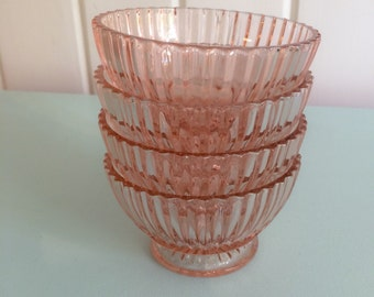 set of pink glass bowls