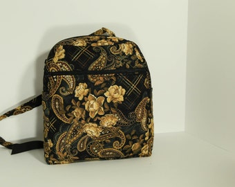 Quilted Backpack purse in metallic gold, black and brown with many pockets