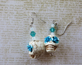 Dangling White Howlite Skulls With Crystals And Blue Rose Eyes
