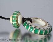 Green, teal lampwork necklace. Handmade by Helen Gorick
