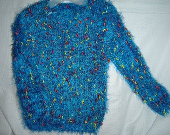 Blue sweater with color splashes , size 4.