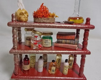 Dolls house Miniature  filled wizard witch three tier display (red/gold)