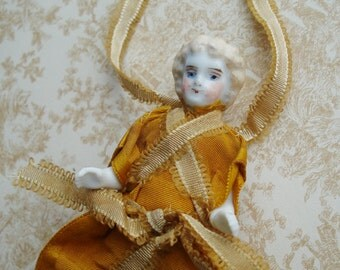 "3 1/4"" Antique Frozen Charlotte Needle Holder Glazed Porcelain Bisque Doll with Original Ribbons & Clothing"