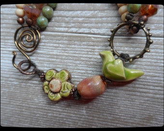 Multi Strand Bracelet Green Bird and Flower primitive assemblage rustic earthy funky