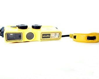 Yellow Minolta Weathermatic-A Waterproof 110 Pocket Camera - Film Tested Working