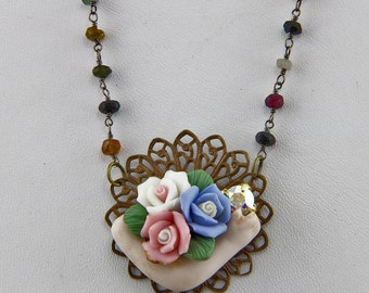 Hand Made Necklace  With Stone Beads Chocolate Brass Ceramic Flowers And An Antique Doll Arm 22 inch Variable Necklace