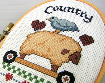 Crow Rides Lamb Vintage Hoop Framed Cross Stitch