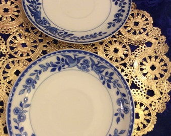 Set of two small plates blue birds/Floral, unmarked about 4 inches