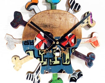 Skull and Bones Skateboard Wall Clock. Boneless Skate Clock made from Recycled Skateboards by Deckstool. New Item - On Sale Now