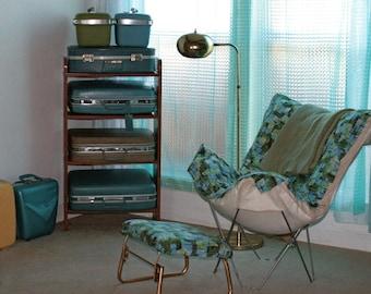 Vintage Mid Century Modernist shelf with luggage suit cases dresser green blue