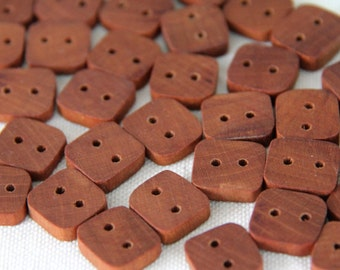 "12 tiny cherry square(ish) buttons - 5/8"" across"